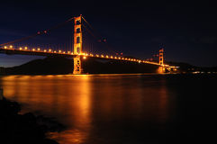 Glowing Golden Gate Bridge from Fort Point Royalty Free Stock Photo