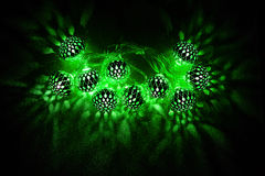 Glowing green lights on dark background Stock Images
