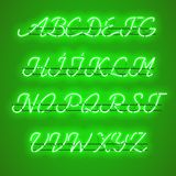 Glowing Green Neon uppercase Script Font. Glowing Green Neon Script Font with uppercase letters from A to Z with wires, tubes, brackets and holders. Shining and Stock Photo