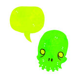 Glowing green skull retro cartoon with speech bubble Stock Photos