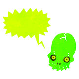 Glowing green skull retro cartoon with speech bubble Stock Photography
