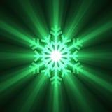 Glowing Green Snowflake light flare Stock Photo
