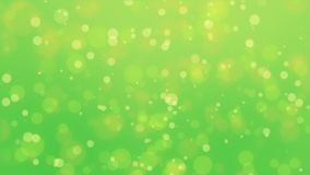 Glowing green yellow background. Beautiful glowing green yellow bokeh background with floating particles stock footage