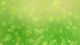 Green yellow bokeh lights background. Glowing green yellow background with floating bokeh lights stock video