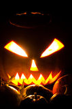Glowing Halloweem pumpkins. Glowing Halloween pumpkin and small pumpkins in front of it Royalty Free Stock Images