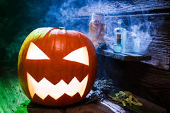 Glowing Halloween pumpkin with blue and green light Royalty Free Stock Photography