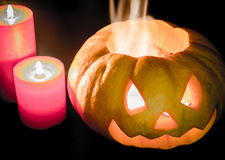 Glowing halloween pumpkin in candlelight Royalty Free Stock Photos