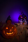 Glowing Halloween pumpkin and ghosts Royalty Free Stock Photo