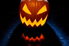 Glowing halloween pumpkin on the marble table Royalty Free Stock Photos