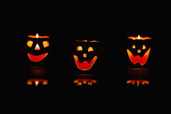 Glowing Halloween pumpkins. Glowing pumpkins with a candle inside. Decorations for Halloween royalty free stock image