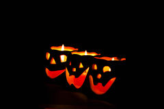 Glowing Halloween pumpkins. Glowing pumpkins with a candle inside. Decorations for Halloween stock photos
