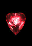 Glowing heart. Glowing glass heart on a black background Stock Photography