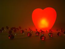 Glowing heart and beads. Red glowing heart and beads Royalty Free Stock Photo