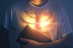 Glowing heart and Bible stock photo