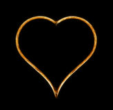 Heart. Glowing heart on black background Stock Images
