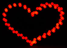 Glowing heart on dark Royalty Free Stock Photography