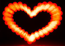 Glowing heart on dark Royalty Free Stock Photo