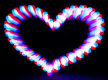 Glowing heart on dark Stock Photography