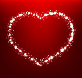 Glowing heart on dark red background Royalty Free Stock Photo