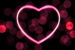 Glowing heart shape. With bokeh lights Royalty Free Stock Photography