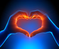 Glowing Heart shapped hands Royalty Free Stock Photo