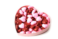 Glowing heart with shiny dots in the box in the form of on white background Stock Images