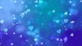 Glowing hearts appear on the shining background. Valentines Day holiday abstract loop animation. Glowing hearts appear on the shining blue background stock video footage