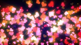Glowing Hearts Particles Loop. Cool animated background that is perfectly looped. These animations are perfect to use with Valentine's Day videos, wedding stock video