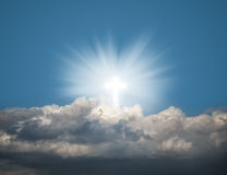 Glowing holy cross in the blue  sky Royalty Free Stock Images