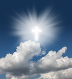 Glowing holy cross in the blue  sky Royalty Free Stock Photos