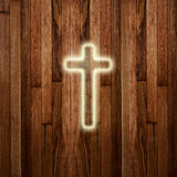Glowing holy cross on wooden background Royalty Free Stock Photos