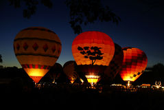 Glowing Hot Air Balloons. In the dark at night Stock Photo