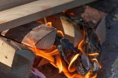 Glowing hot charcoal briquettes close-up background texture. bonfire Stock Photos