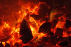 Glowing hot charcoal briquettes close-up background texture. bonfire Royalty Free Stock Photography