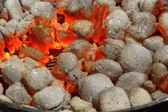 Glowing Hot Charcoal Briquettes Close-up Background Texture Royalty Free Stock Images