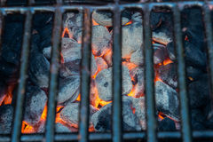 Glowing hot charcoal briquettes Royalty Free Stock Photos