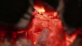 Glowing hot wood embers on closeup stock footage