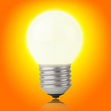 Glowing incandescent light bulb on yellow-orange. Background with clipping path Royalty Free Stock Photo