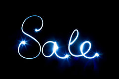 Glowing inscription SALE on a black Stock Image