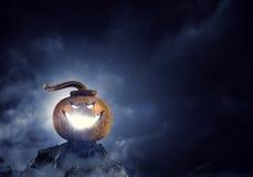 Glowing jack lantern. Mixed media Royalty Free Stock Photo