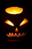 Glowing Jack-o'-lantern. Glowing carved pumpkin of Halloween - Jack-o-lantern Stock Image