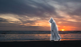 Glowing Jesus Sunset. Jesus Christ in walking along a beach at sunset Stock Image