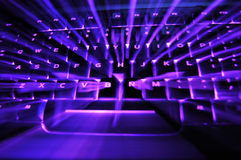 Glowing keyboard. A purple glowing backlit illuminated keyboard with bursting light in between the keys Stock Images