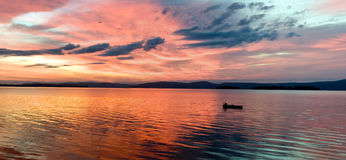 Glowing lake sunrise. Scenic, early morning sunrise over calm lake.  Lake Champlain, Vermont (USA Stock Image
