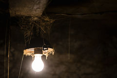 Glowing lamp in a barn Stock Photography