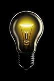 Glowing lamp on black Stock Photos