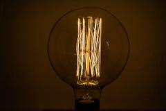 Glowing lamp on black Stock Photo