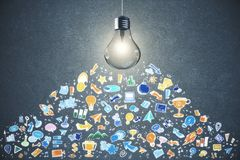 Idea and solution concept. Glowing lamp and business sketch on concrete wall background. Idea and solution concept Royalty Free Stock Photo