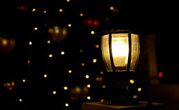 Glowing lamp at dark night,  bright light in darkness Royalty Free Stock Photo
