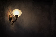 Glowing lamp on the wall Stock Photography